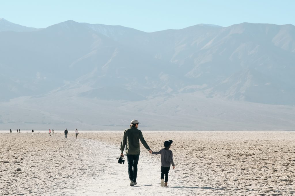 Father and son walking in Death Valley National Park on family vacation