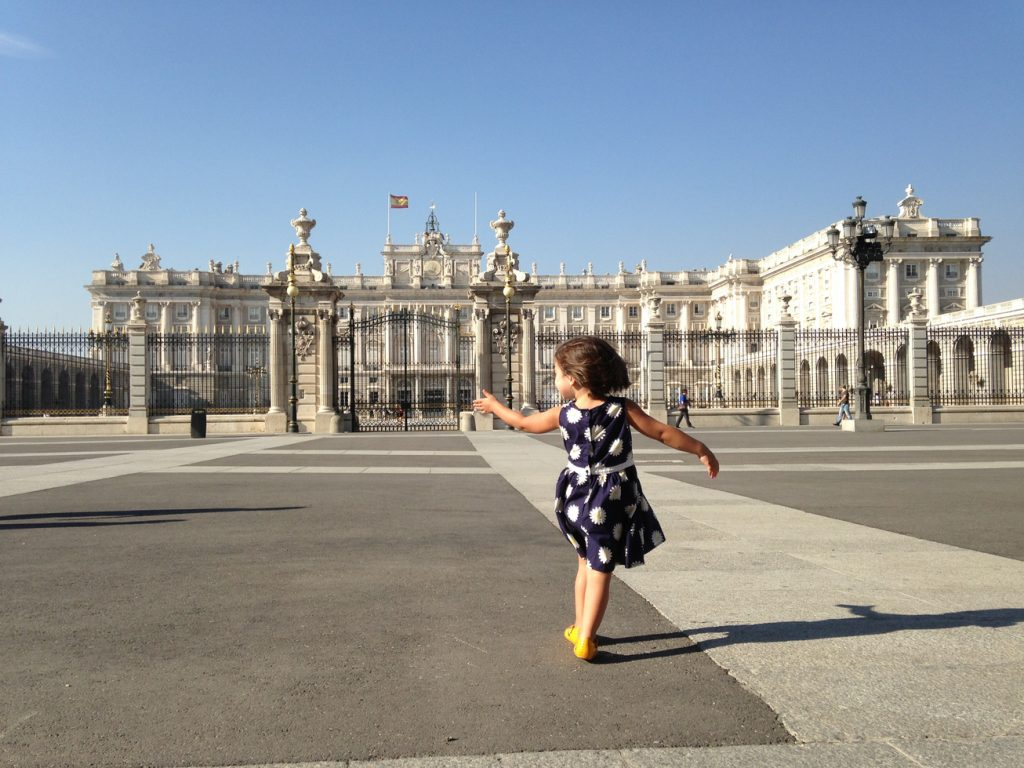 Girl in front of Royal Palace in Madrid