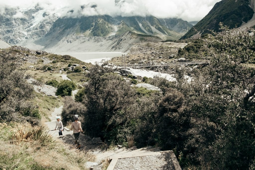 Family hiking on Hooker Valley Track in New Zealand