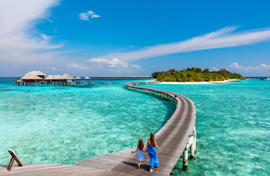 Family on boardwalk in Maldives