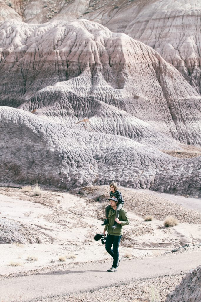 Father and son hiking through Petrified Forest National Park