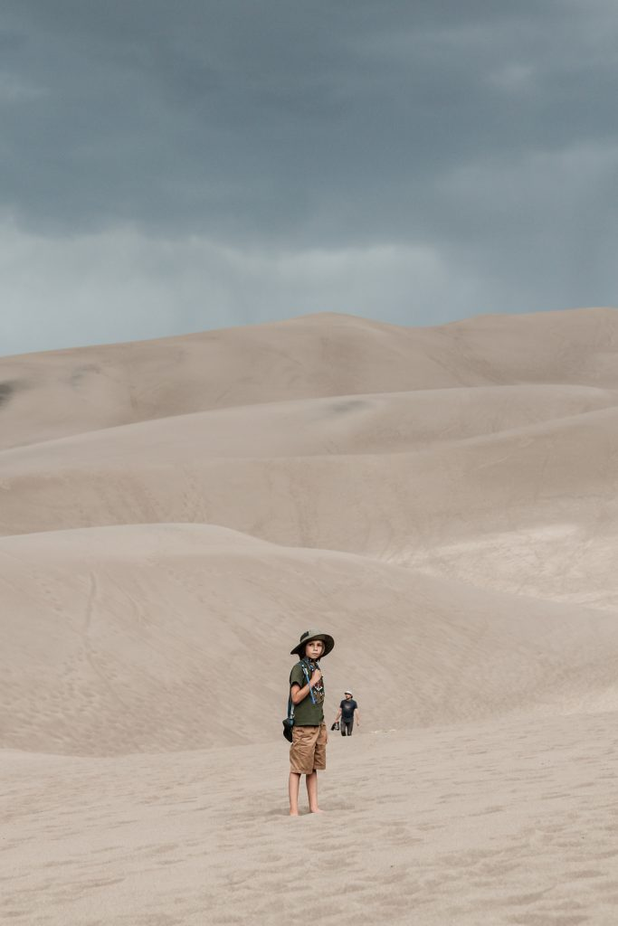 Boy hiking through Great Sand Dunes National Park