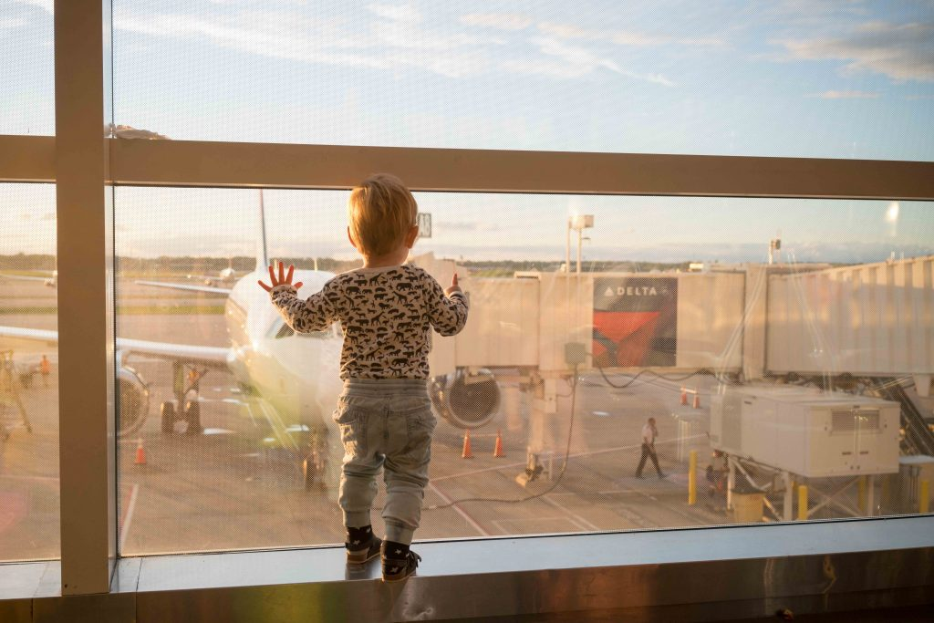 flying with kids: toddler at airport