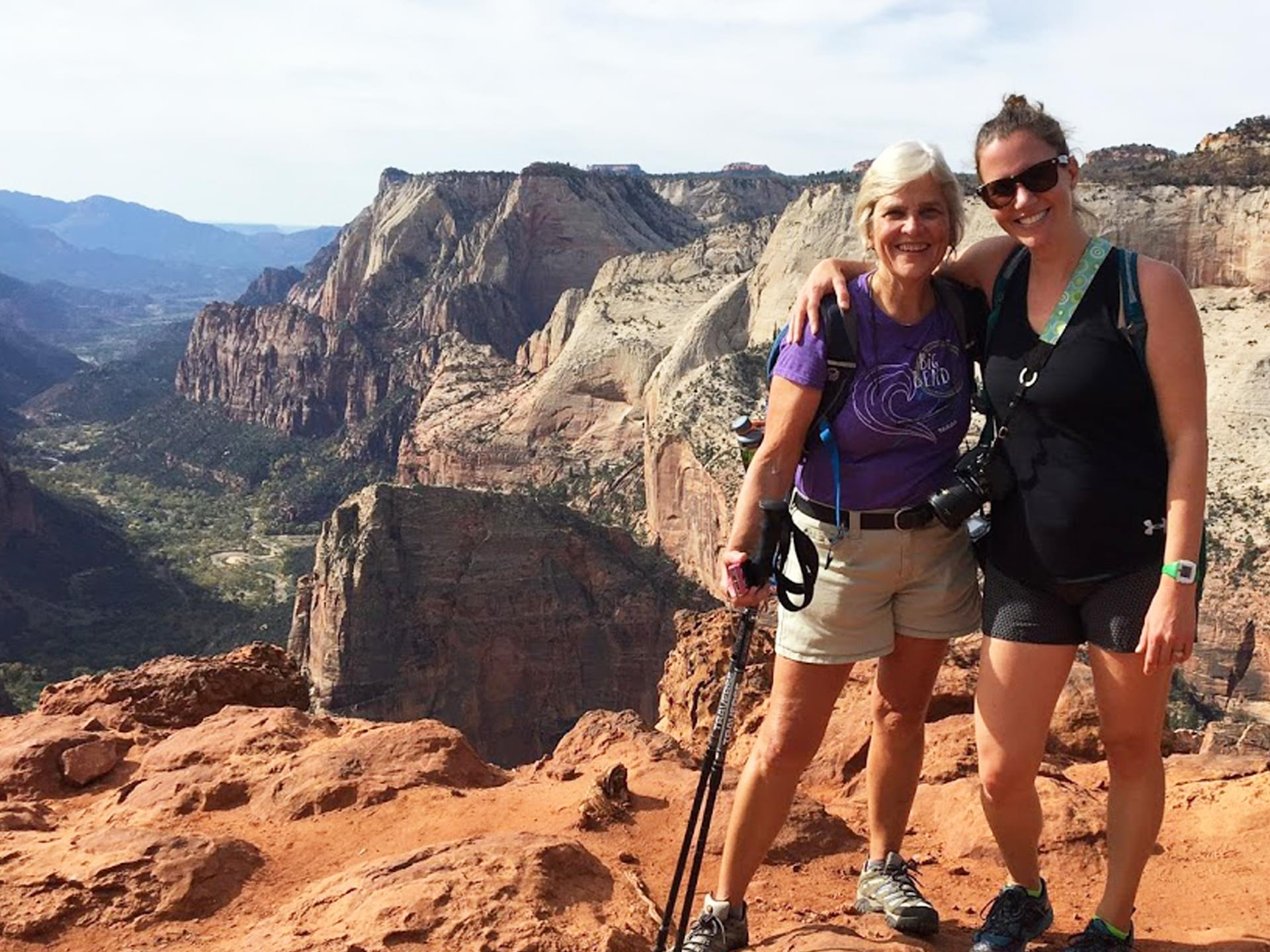 two hikers on observation point in zion national park