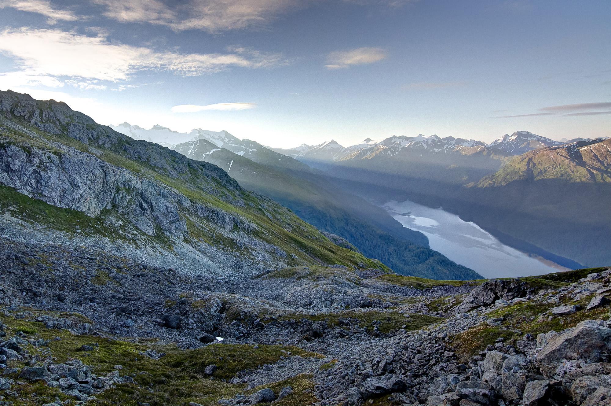 Sun coming through mountains. Credit: Ben Adams.