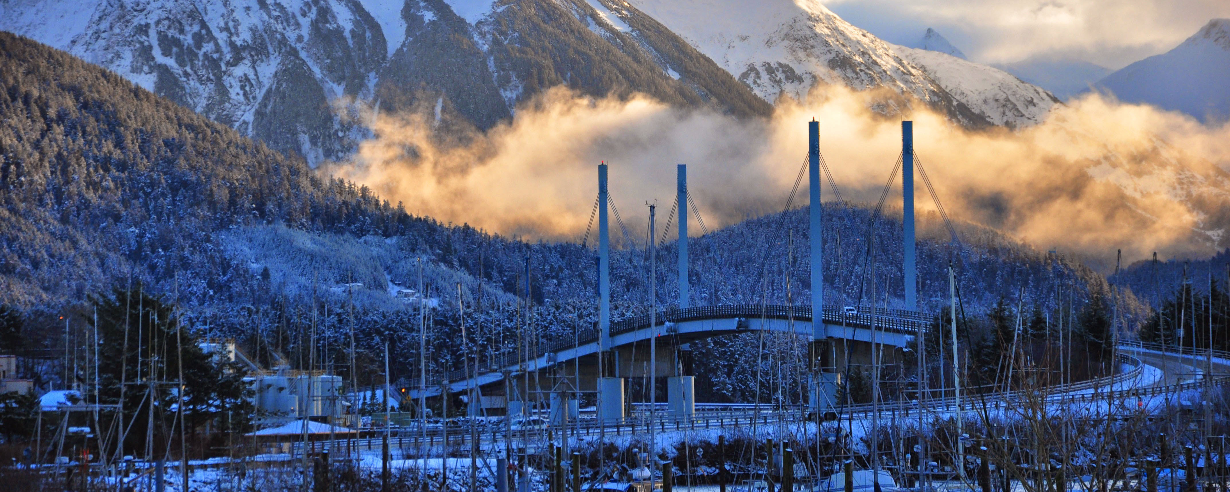 Bridge and mountains in blue light. Credit: Berett Wilber.