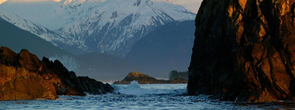 Ocean breaking between rocks. Credit: James Poulson.