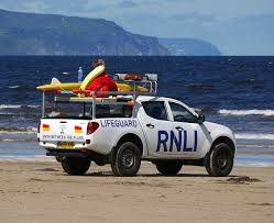 Photo of a life guard pickup truck on the beach.