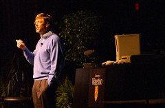 Photo of Bill Gates speaking at a school.