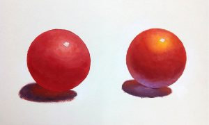 Comparison of two red balls: Straight red on the left, warm and cool colors added to red ball on the right.