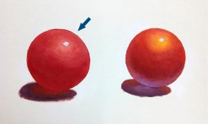 Comparison of two red balls: Left ball has minimal visual interest due to fewer colors used (red, black, white)..