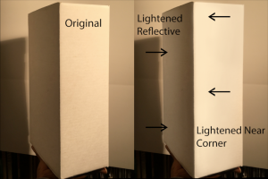 Comparison of two flat-sided, rectangular objects: Right hand image visually protrudes due to light/shadow gradient and reflective lighting.