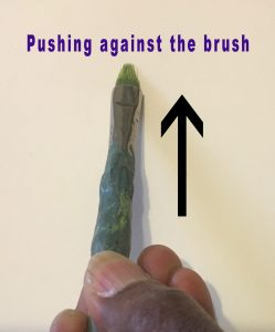 Technique to push against the brush when painting grass blades with an old, uneven brush.