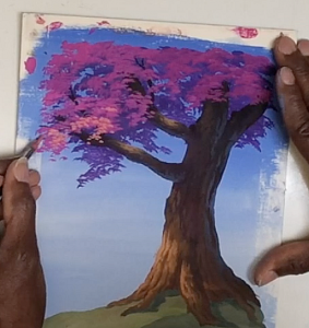 Painting in lighter value leafiness to the tree foliage.
