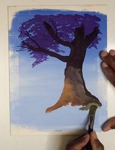 Painting in the tree trunk and branches from dark to light values