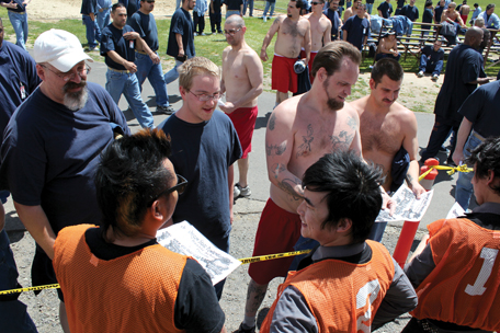 The Slants signing autographs at Oregon State Penitentiary