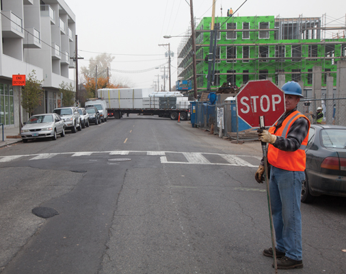Division Street in Southeast Portland: Construction continues on several mixed-use buildings and the infrastructure that goes with them. With hundreds of new units being built and little to no additional parking, density and congestion will continue in close-in Portland. Photo by Tim LaBarge.