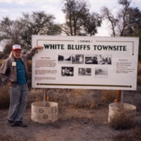 (Former) White Bluffs town site sign, Harry Anderson pointing at it<br />