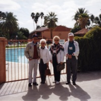 Juanita and Harry Anderson standing next to another couple in front of gated pool<br />