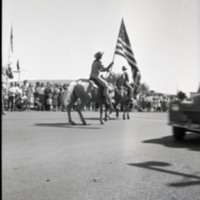 Parade-Person on Horse with Flag