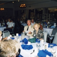 White Bluffs reunion attendees seated at banquet table<br />