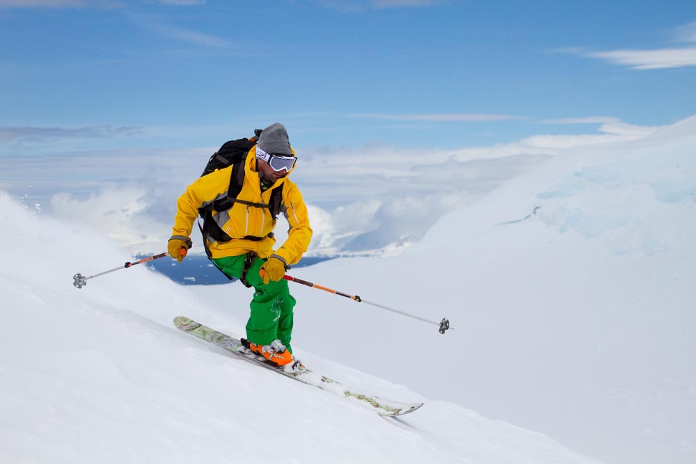 A guided ski touring expedition in Antarctica while on a One Ocean Expeditions polar adventure cruise. Photo: Gabe Rogel
