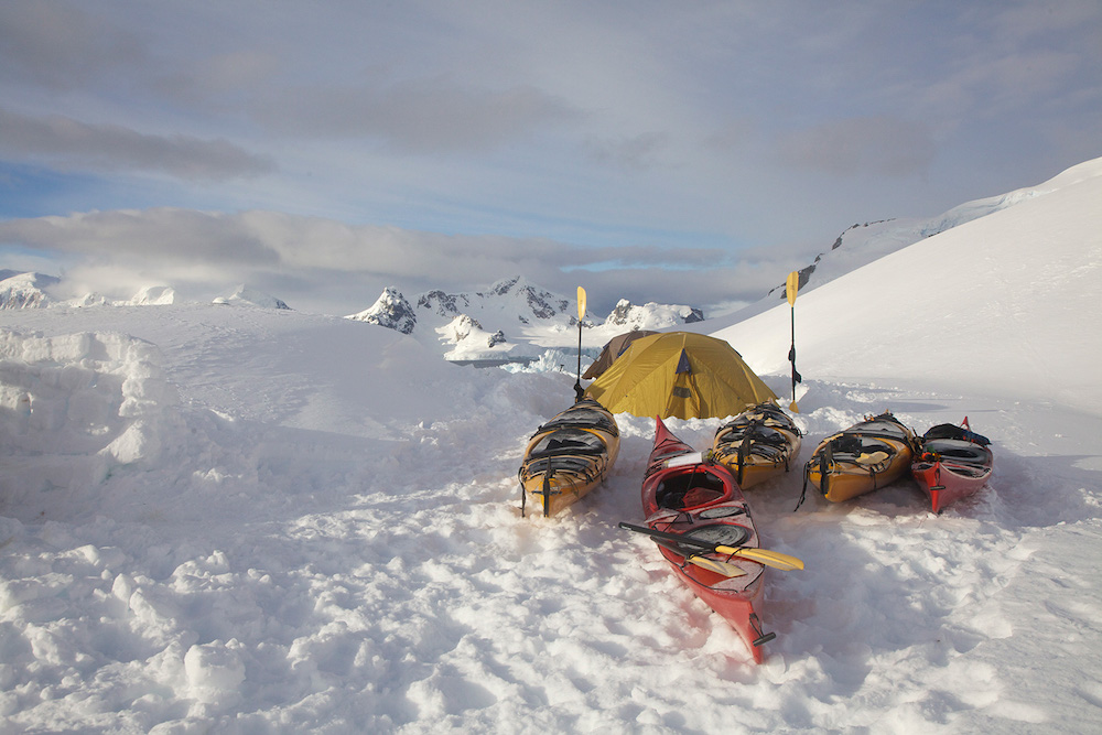One Ocean Expeditions passengers camping in Antarctica after a day of sea kayaking. Photo: Liz Gifford
