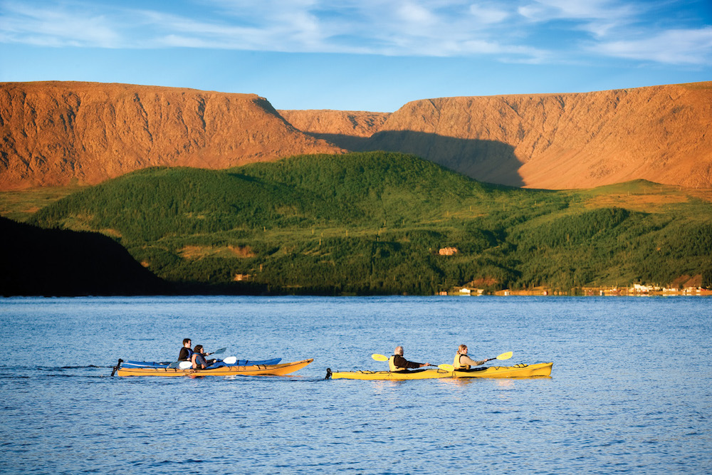 One Ocean travelers explore Labrador's coastline in sea kayaks. Photo: Barrett & MacKay