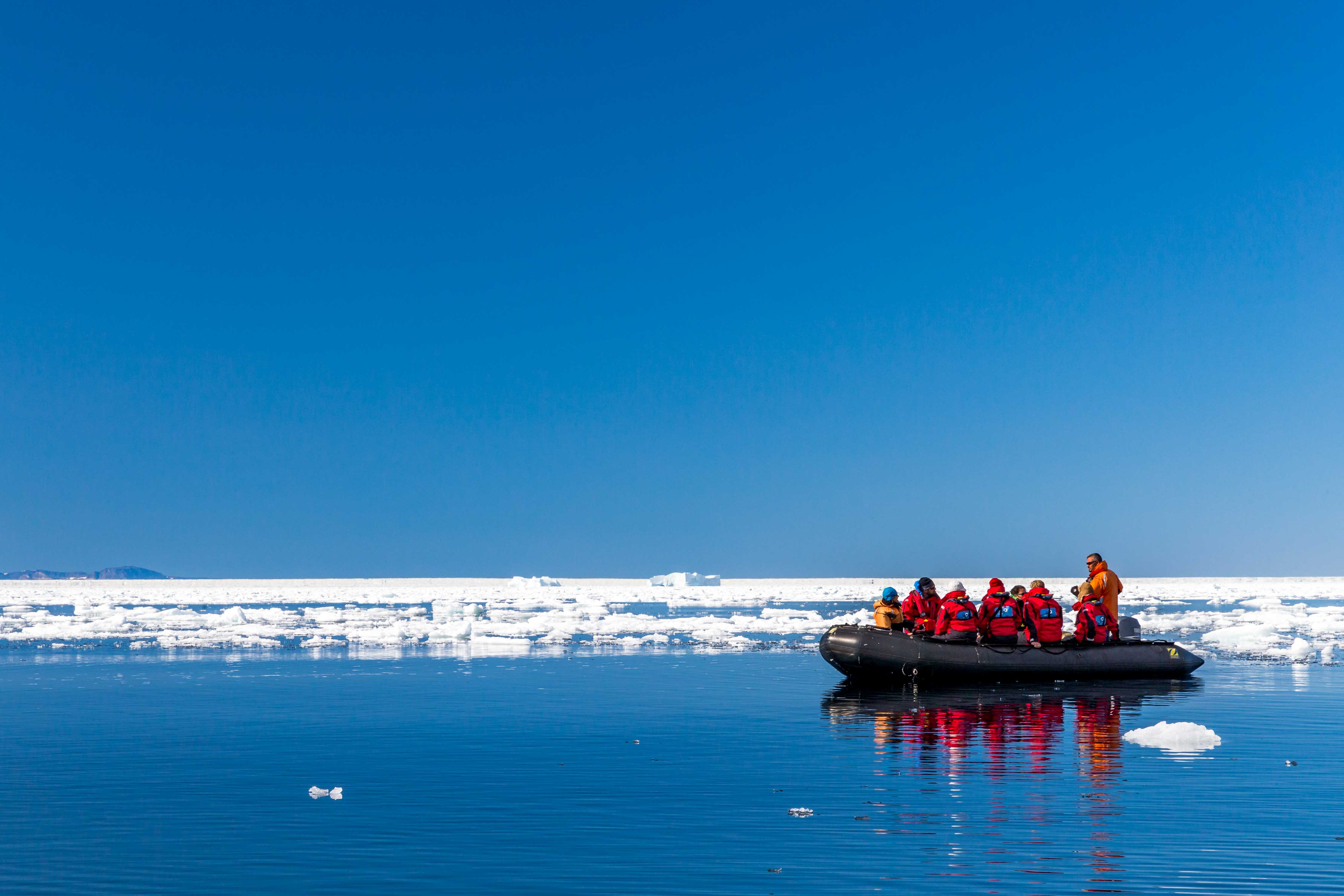 A One Ocean Expeditions excursion ventures out during a Northwest Passage cruise.