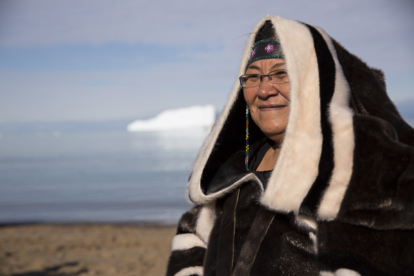 Expedition passengers meet Inuit in the Canadian Arctic.