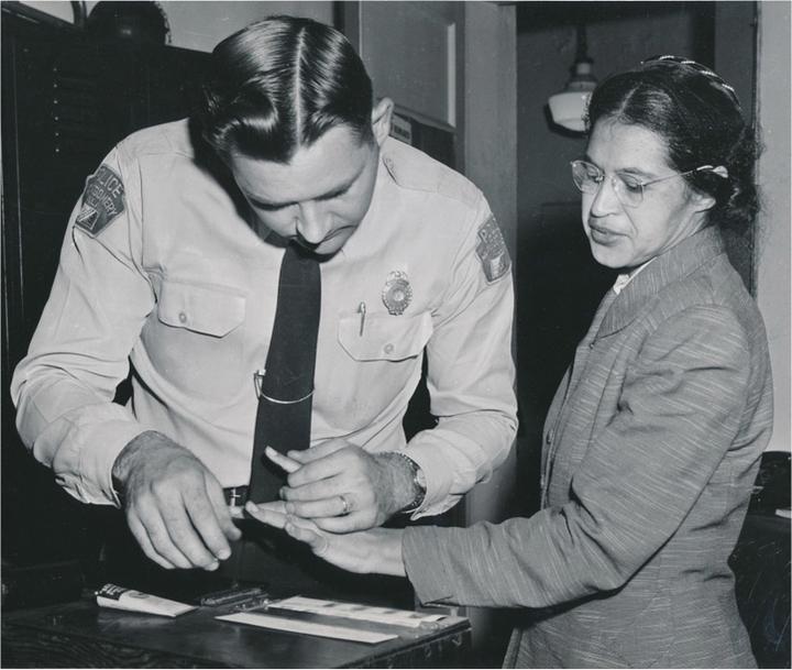 A deputy fingerprints Rosa Parks.