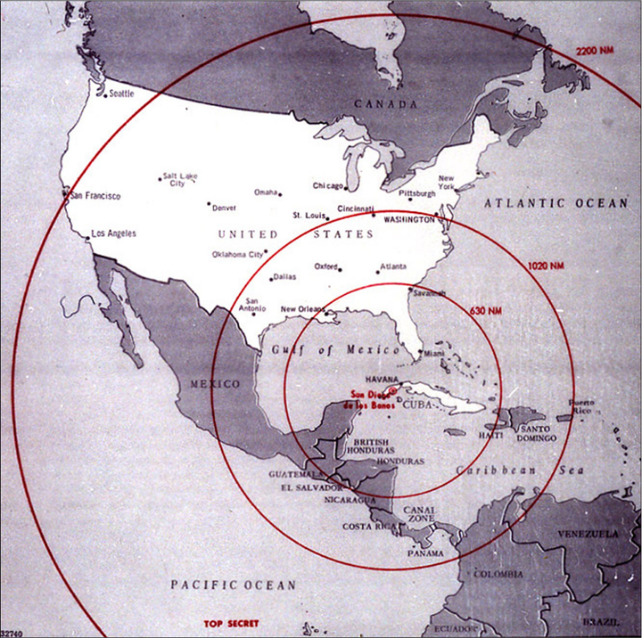 A map of the western hemisphere with three concentric circles centered around San Diego de los Baños in Cuba. The first circle, labeled 630 NM includes Savannah, Georgia, parts of Mexico, Guatemala, and Nicaragua, British Honduras, Honduras, Cuba, and parts of Haiti. The second circle, labeled 1020 NM, reaches farther, and includes the southeastern United States, half of Mexico, Costa Rica, Haiti, Santo Domingo, Puerto Rico, Panama, and the northwestern tip of South America. The third circle, labeled 2200 NM, includes all of the United States except the northwestern-most part, the eastern half of Canada, and most of South America.