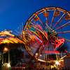 A Ferris wheel and carnival rides provide family thrills at the Magnolia Festival of Oklahoma in Durant.