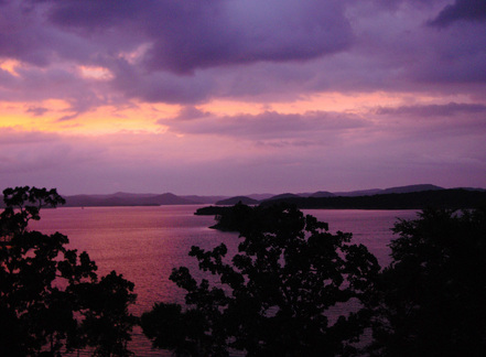 A romantic sunrise over Broken Bow Lake near Beavers Bend State Park.