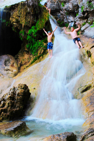 Kids can explore the 77-foot waterfall and swim in natural pools at Turner Falls Park in Davis.