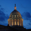 The Guardian statue stands like a sentinel above the Oklahoma State Capitol dome at dusk on an Oklahoma City evening.
