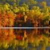 Gorgeous fall colors reflect on the water at Beavers Bend State Park.
