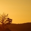 Sunrise spills golden hues over the rugged landscape of the Wichita Mountains Wildlife Refuge.