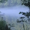 An early morning mist rises over the still-as-glass Mountain Fork River, offering incredible views to hikers in Beavers Bend State Park.