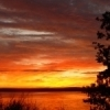 The sky is ablaze with color as the sun rises over the Arrowhead Area at Lake Eufaula State Park.