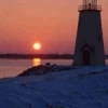 The Lake Hefner Lighthouse stands as a lonely beacon in the frosty grip of winter.  Lake Hefner is located in northwest Oklahoma City and is home to many water sports during the summer months.