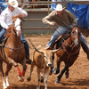 Team ropers go all out while competing at the International Finals Youth Rodeo in Shawnee.