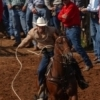 A competitor ropes a calf during the International Finals Youth Rodeo in Shawnee.