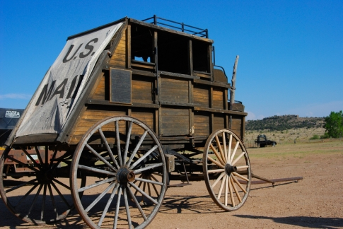 An authentic stagecoach stands on the grounds of the Hitching Post Ranch in Kenton.  Guests can stay at the ranch and help with cattle round-ups, branding and ranch chores, or just relax and enjoy horseback riding and the outdoors.