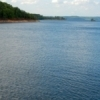 Blue waters shimmer at Broken Bow Lake in southeastern Oklahoma's Beavers Bend State Park.