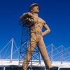 The Golden Driller, one of the tallest statues in the world, greets visitors to the Tulsa State Fairgrounds.  He's survived tornadoes and turbulent oil markets and has stood tall as a reminder of Tulsa's roots as an oil boom town on Route 66.