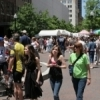 Some of the 300,000 visitors to Tulsa's International Mayfest stroll past artists' booths on Main Street.  This event showcases the works of more than 120 artists and features live music and great festival food.