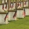The grounds of the Oklahoma City National Memorial & Museum feature a field of empty chairs representing each life lost during the Federal Building bombing in 1995.  Here, they are decorated with American flags.