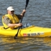 OKC Kayak provides paddling school instruction to clients and then helps them get started immediately on Lake Hefner in Oklahoma City.  Here, a student cruises the lake.