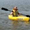 The whole family can quickly learn to paddle at the OKC Kayak school.  They've taught every age from 5 to 101.  Here, a student paddles on Oklahoma City's Lake Hefner.